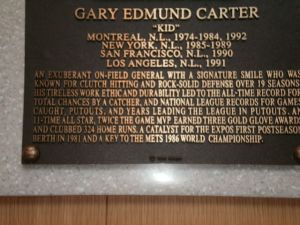A close-up of Gary Carter's plaque detailing his importance to the 1986 Mets.