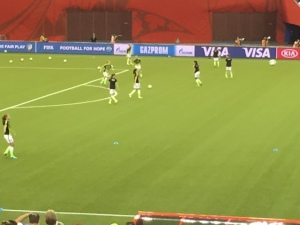 The U.S. warming up before the match. Twenty years from now in footage from the tournament Nike's ridiculous neon-and-black uniforms are going to look super-dated.